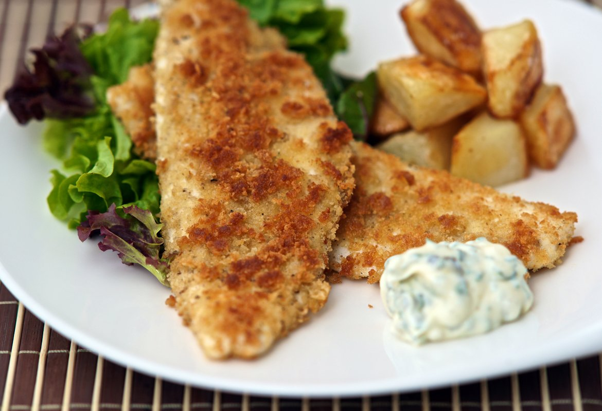 Whiting is one of the best fish for good old fashioned fish'n'chips. Baking cubes of potato gives a much crisper result than deep-frying and this herb mayonnaise makes an interesting alternative to the traditional tartare sauce.